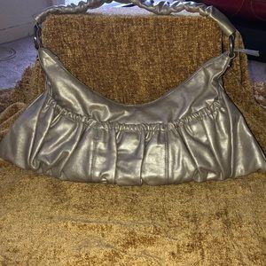 Silver pearlized hobo international handbag